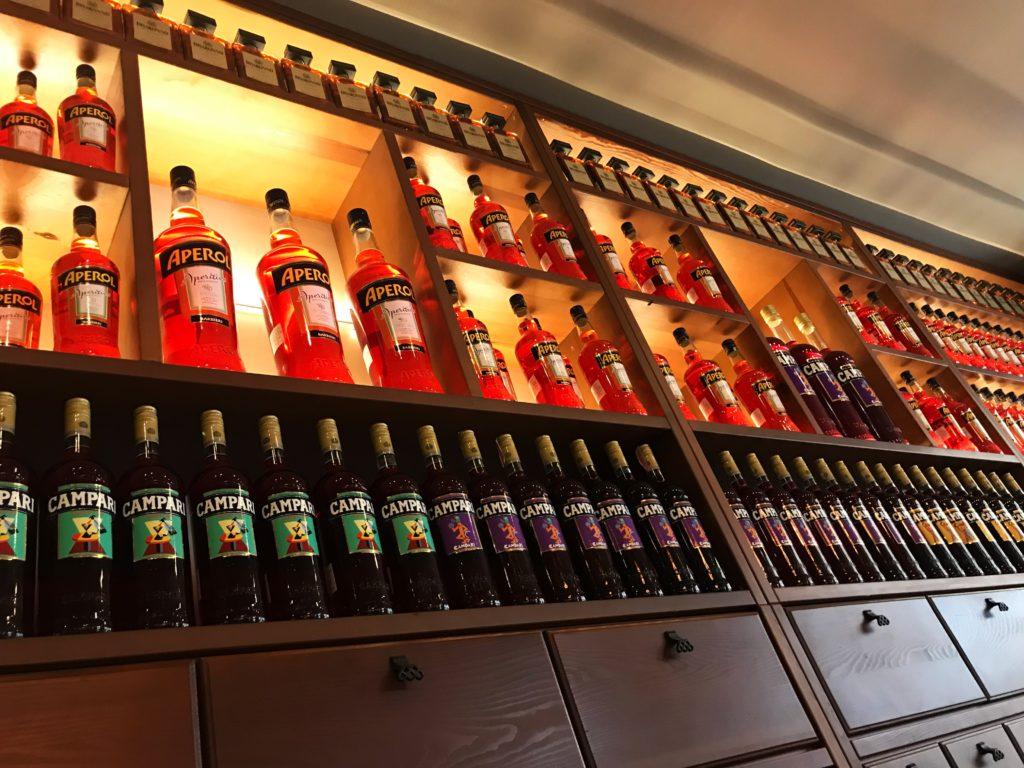 Bottles of Aperol on a shelf