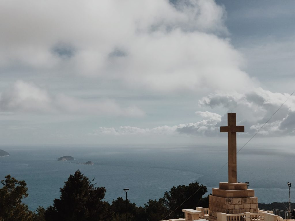 Giant christian white stone cross at the hill above Dubrovnik
