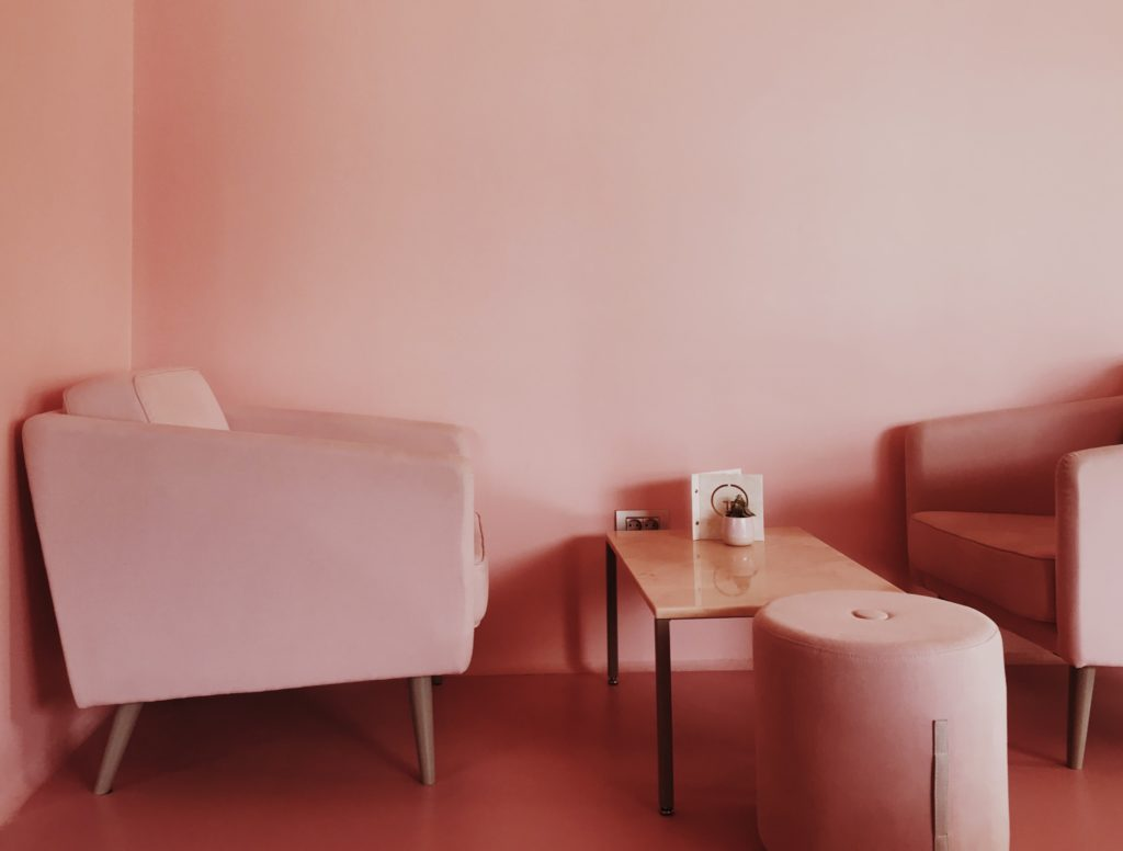 Pink chair and pink wall interior decoration