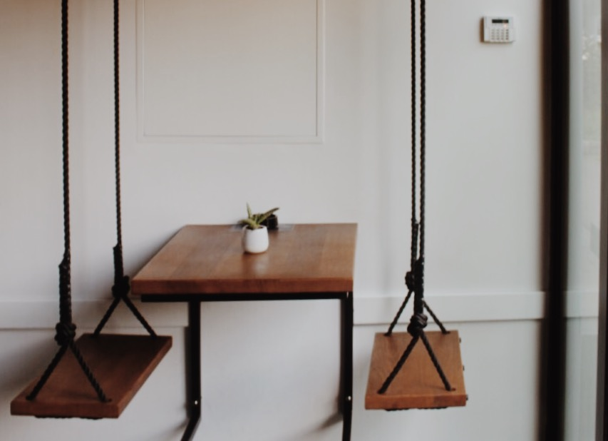 Tables that instead of chairs have swings