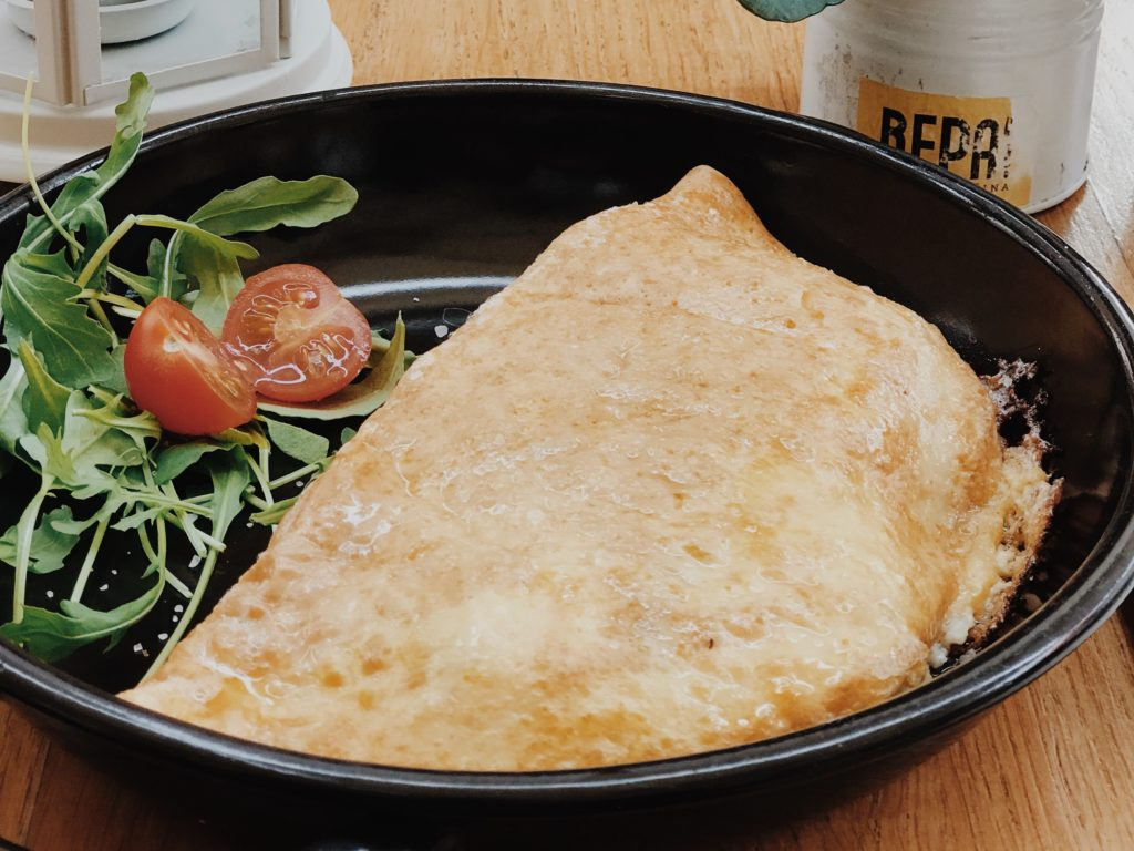 French breakfast omelette with small tomato