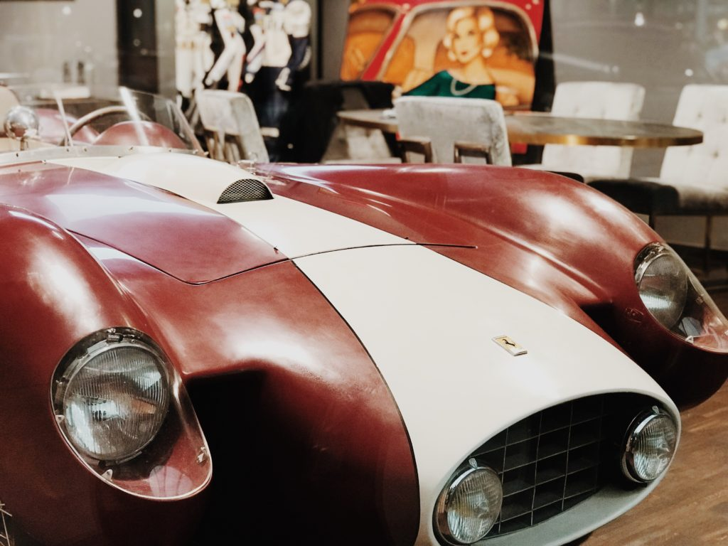 Red and white vintage Ferrari front side detail