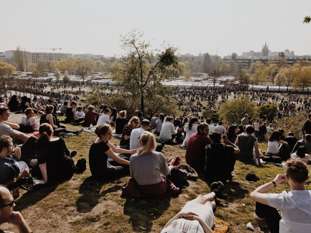 Early spring afternoon at the Mauerpark amphitheater. Crowd of people sitting