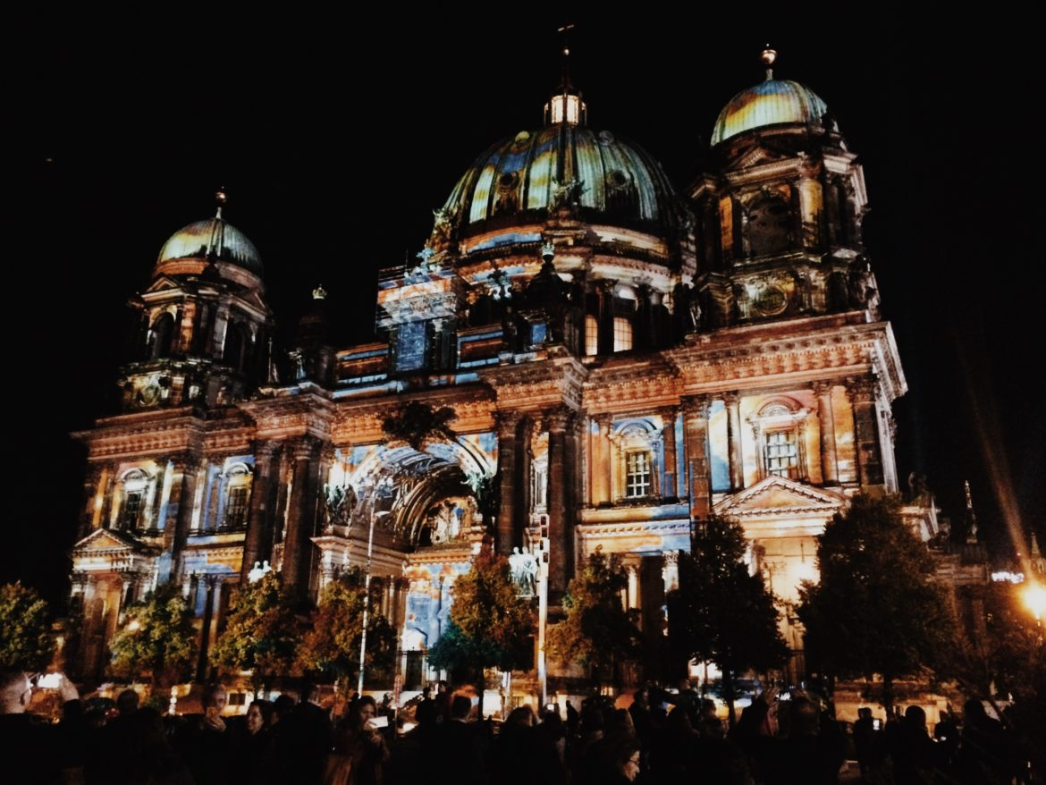 Berliner Dom illuminated by colorful images during Festival of Lights