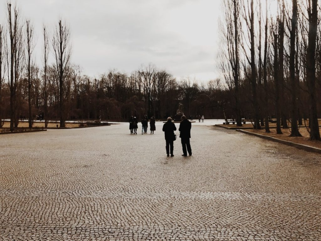 People walking in park in the aftermath of winter time, Berlin, Germany