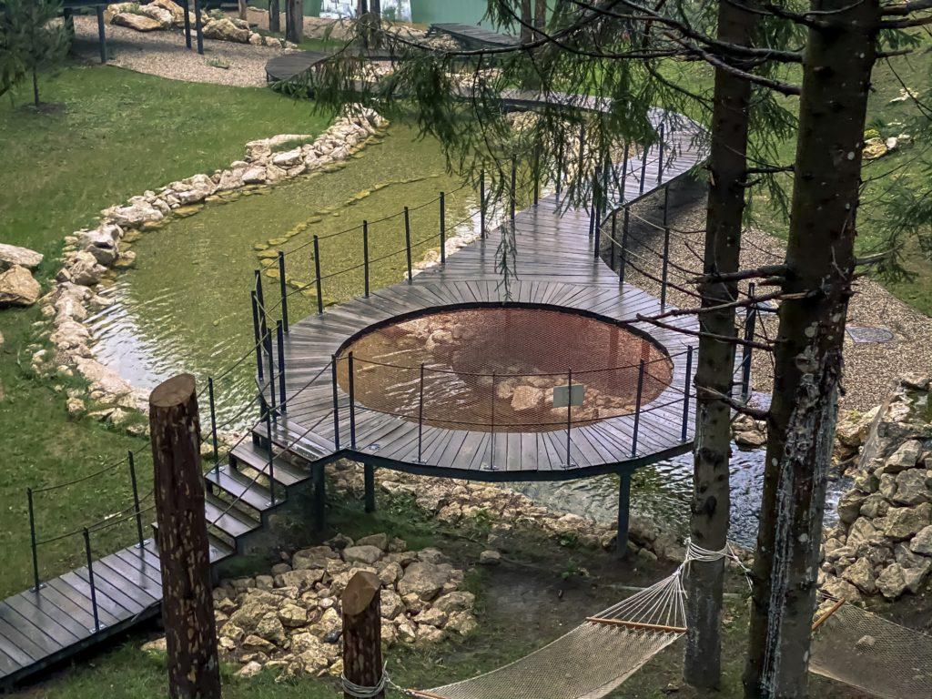 A circle-shaped bridge above a small river