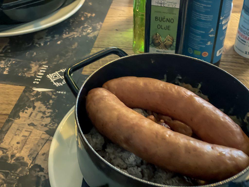 Kranjska klobasa, smoked sausage with sauerkraut and buckwheat mush