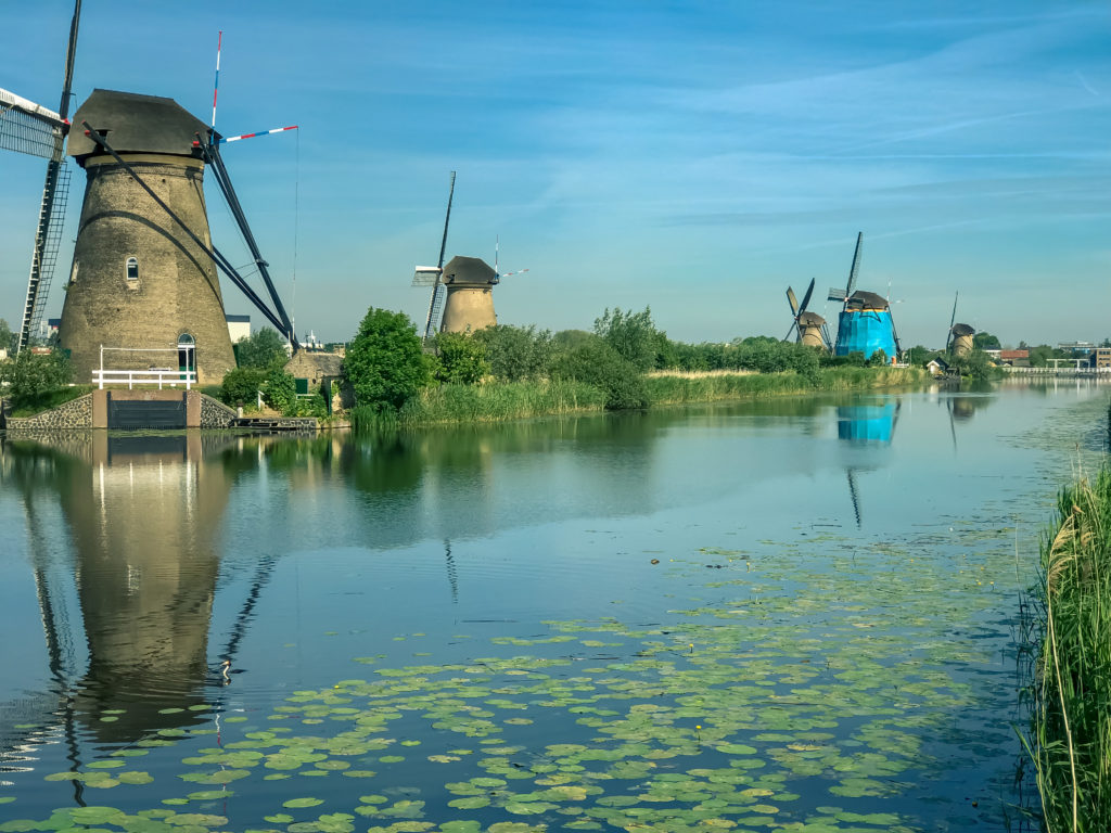 Traditional dutch windmill with reflection at water, Kinderdijk, Rotterdam, Netherlands