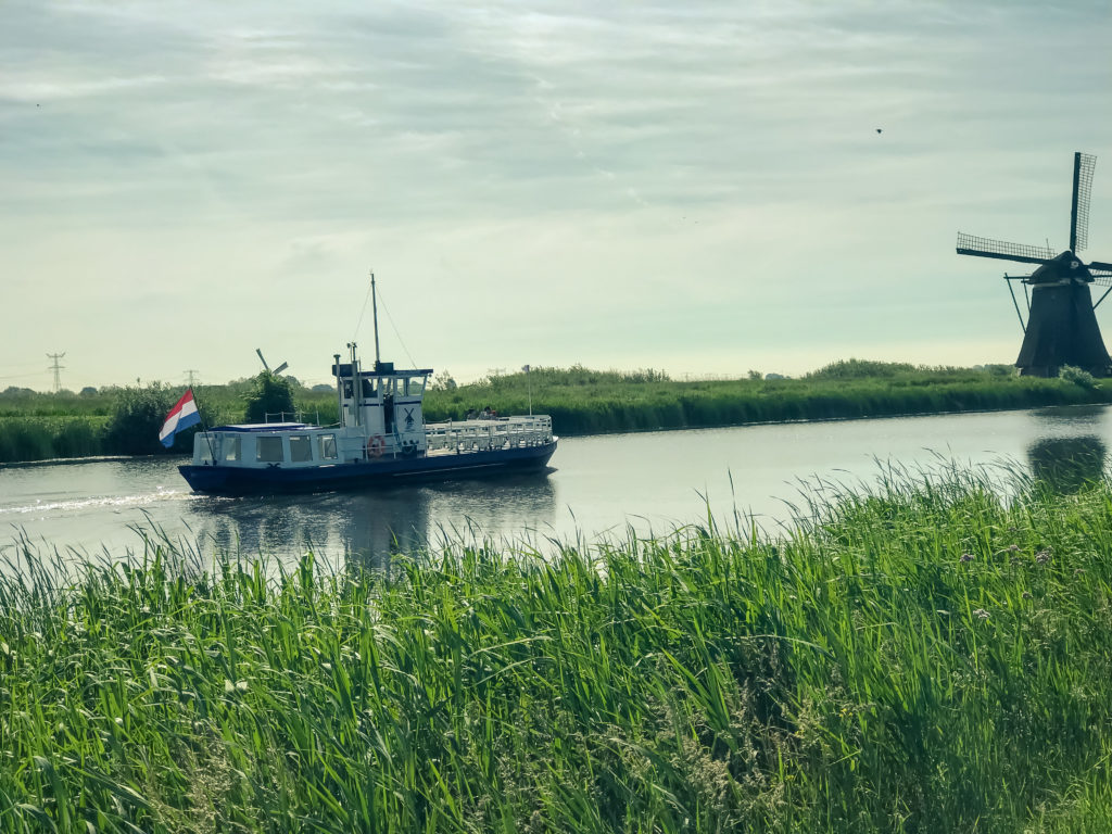 Sightseeing Boat With Tourists In Kinderdijk, Rotterdam, Netherlands
